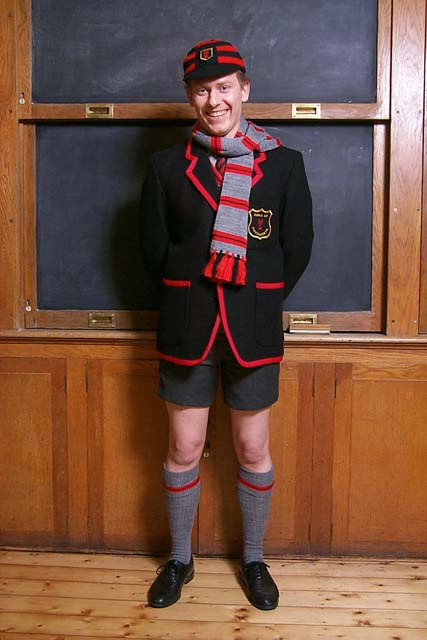 Adult Schoolboy in winter uniform