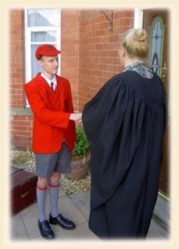 Miss Prim welcomes a new boy at Prep. School