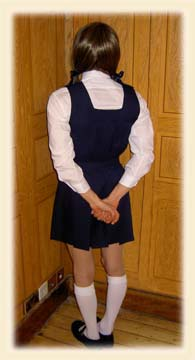 Adult school girl made to stand in the corner
